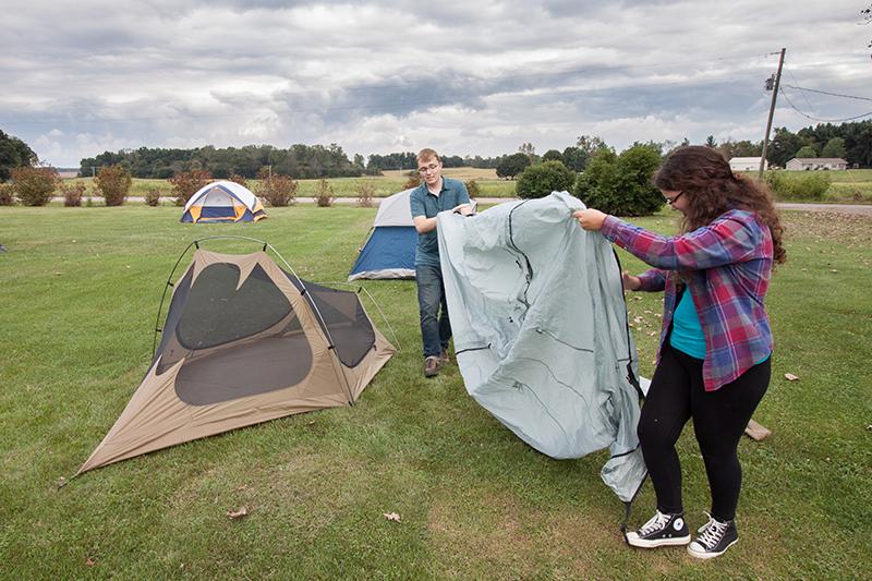 students set up tents