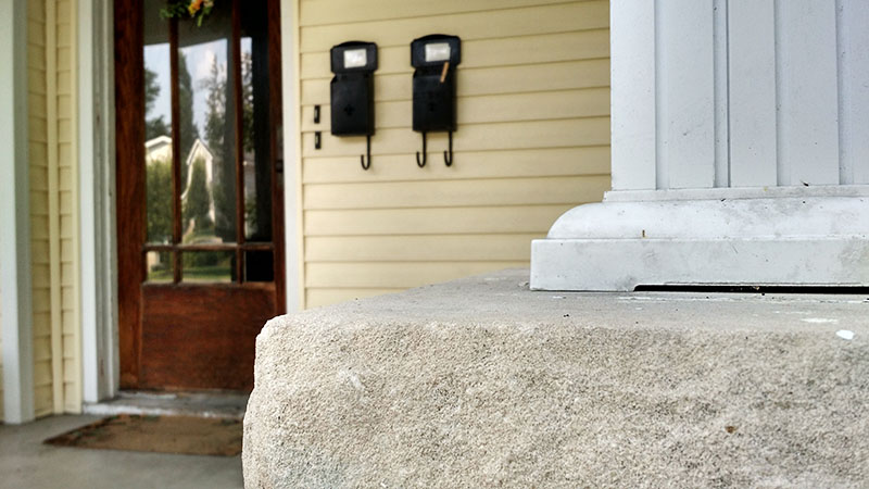 The porch, door, and mailboxes of Elizabeth Franks-North's off-campus home