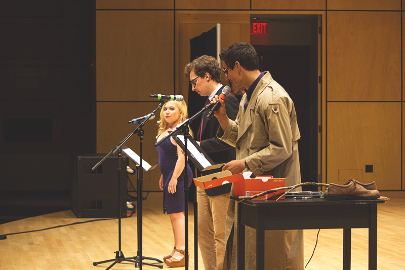 """Halle Steingass, Phil Longenecker, and Lucas Harnish took first place with their recreation of Garrison Keillor's """"A Prairie Home Companion."""" Photo by Hannah Sauder."""