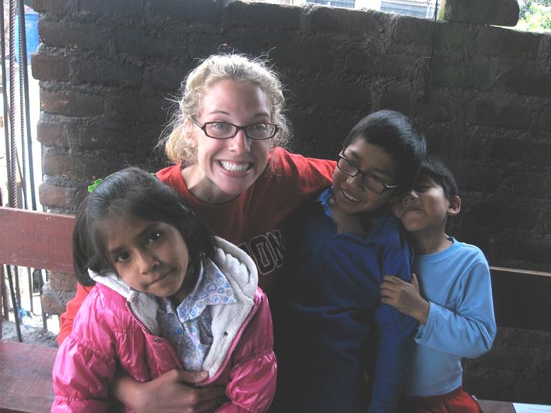 Kate Stoltzfus with children in Peru