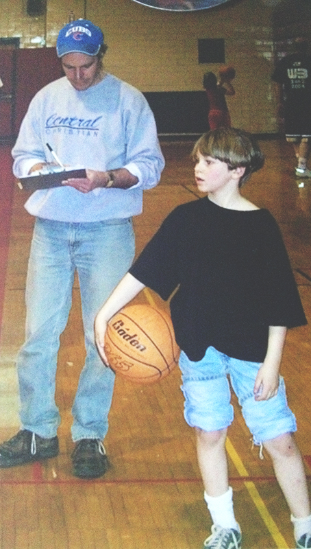 Photo of nine year-old Seth Wesman holding a basketball in a gym