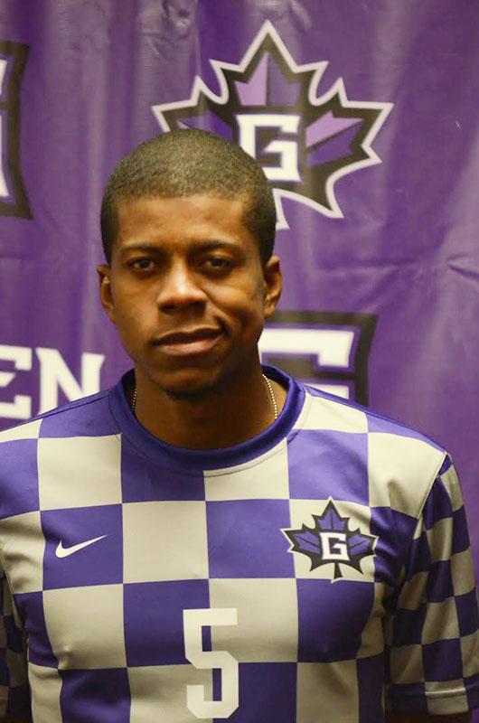 Portrait of Tevin Gilkes in his number 5 Goshen College men's soccer jersey