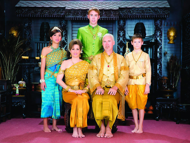 Keith Graber Miller and his family wear traditional Cambodian clothing for a picture