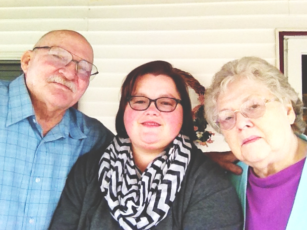 Kelly Poff and her grandparents pose for a picture