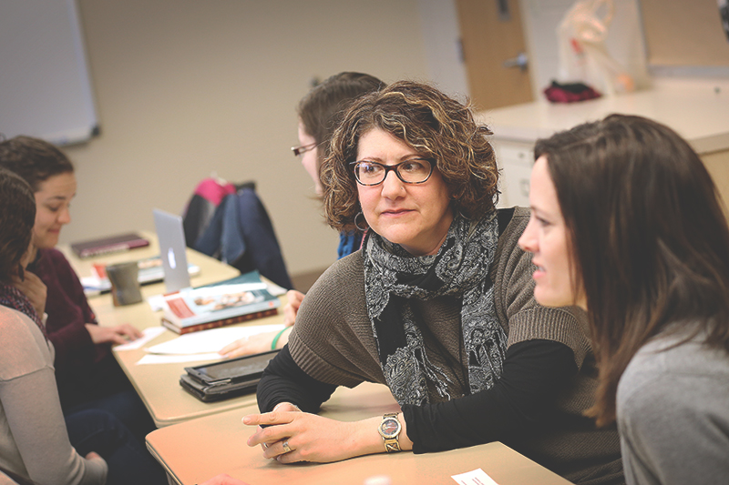 Suzanne Ehst, associate professor of engages with students during an education course. Photo contributed by Comm-Mar.