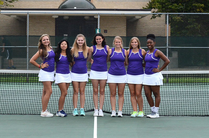 The seven members of the Goshen women's tennis team pose for a picture on the court