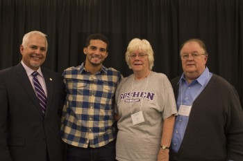 Trever Emery, a senior, with his grandparents, Mary and Robert Emery and President James Brenneman.   Photo by Hannah Sauder.