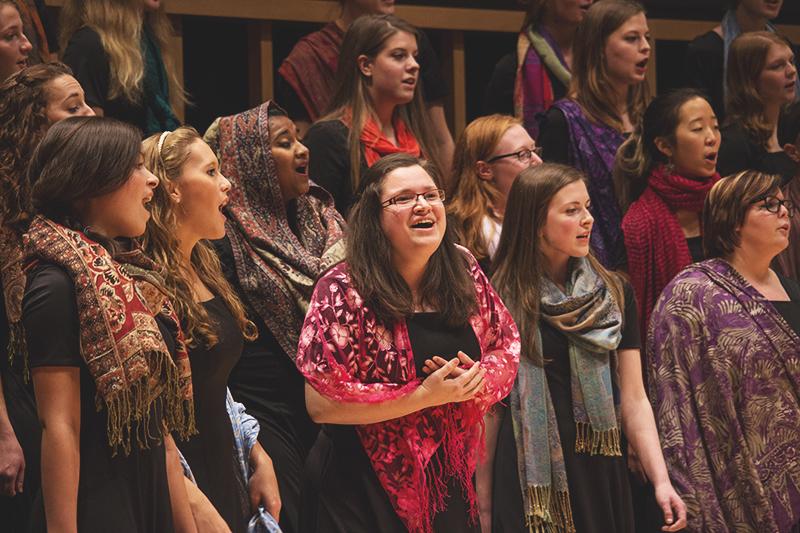 Miranda Earnhart sings a solo during the Women's Choir's performance