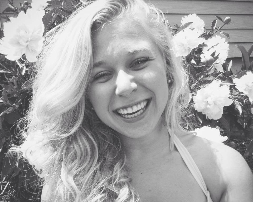Black and white image of Halle Steingass laughing