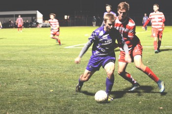 Nate Nussbaum takes the ball in Saturday's semifinal game.  Photo by Maria Bischoff.