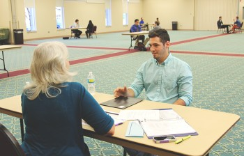 Bryan Aponte Ortiz practices his interviewing skills at Super Tuesday. Photo by Dona Park.