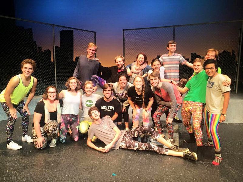 The cast of Godspell 2012 poses for a picture in brightly colored leggings