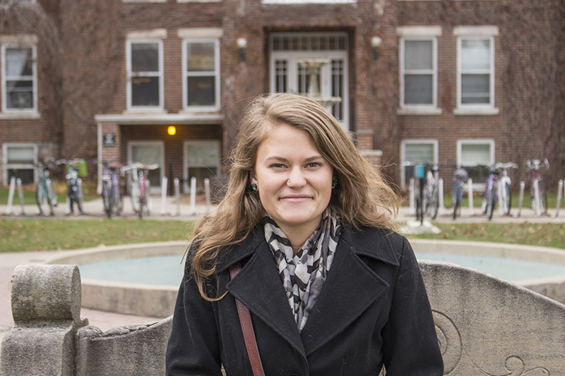 Photo of Joanna Epp in front of the fountain outside Kulp Hall