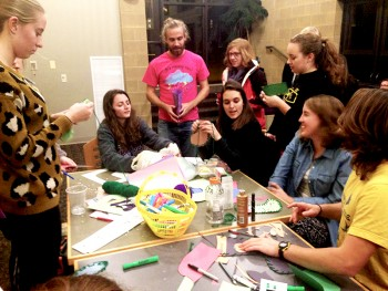 """Students create construction paper stockings for their friends at the second event of the """"12 Days of Christmas."""" Photo by Emma Koop Liechty."""