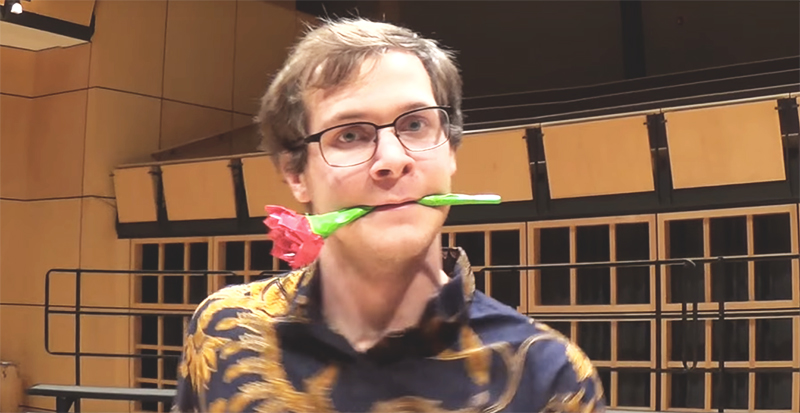Wade Troyer holds a flower between his teeth for a picture