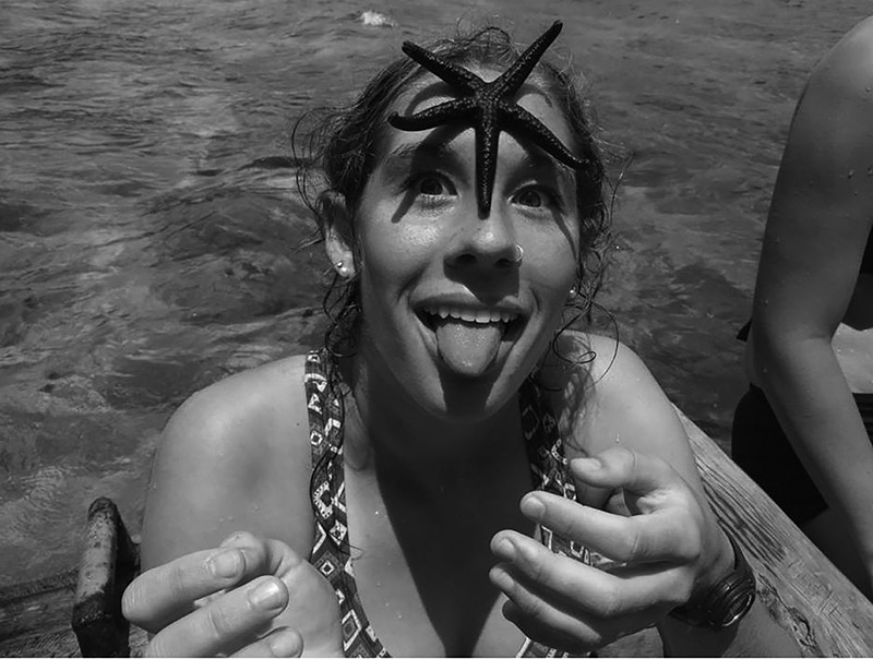 Photo of Annaliese Baer with a starfish on her forehead
