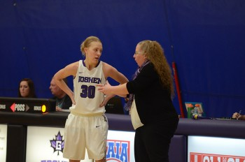 Coach Stephanie Miller talks to junior Sophia Sears during the game against Marian University. Photo by Maria Bischoff