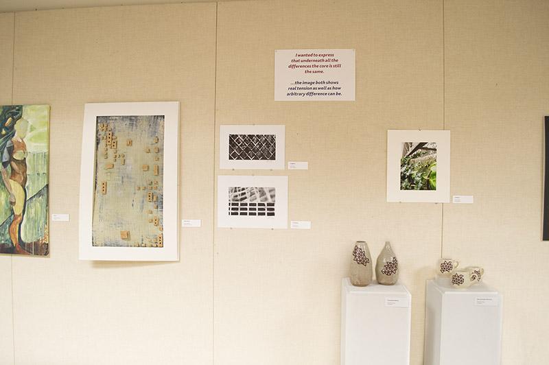 Student art exhibit on wall