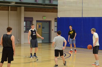 Members of the practice squad run an opponent's play during practice.  Photo by Maria Bischoff
