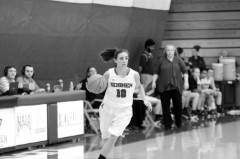 Haley Archibeque, freshman, brings the ball up the court for the Maple Leafs. Photo by Maria Bischoff