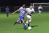 Isaac Huerta dribbles past a Spring Arbor opponent this fall when he was named First Team All-Crossroads League. Photo by Maria Bischoff