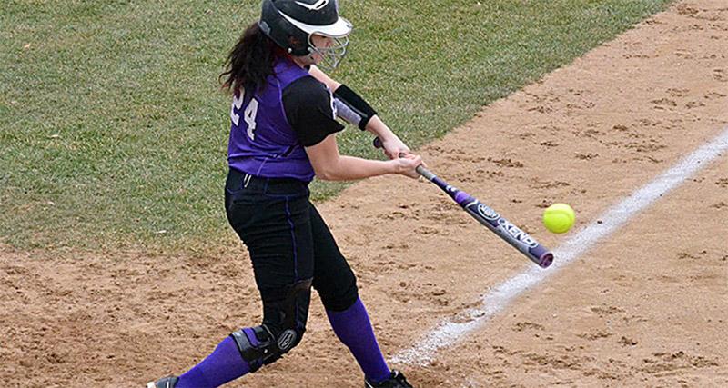 Softball player making a hit
