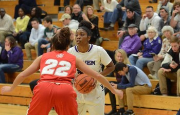 Lynnia Noel, junior, runs the offense for Goshen. On Wednesday night the women's basketball team was selected to play in the NAIA national tournament. Photo by Maria Bischoff