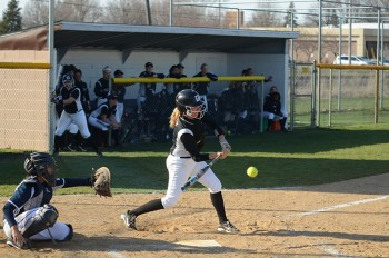Krista Sutliff, junior, bats for the Maple Leafs against Spring Arbor University. Photo by Maria Bischoff