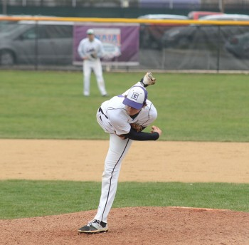 Michael Walker, junior, pitches against Grace College. Photo by Maria Bischoff