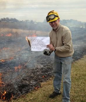 Ryan Sensenig burns the prairie in support of Bernie Sanders on Saturday.  Photo by Laura Miller