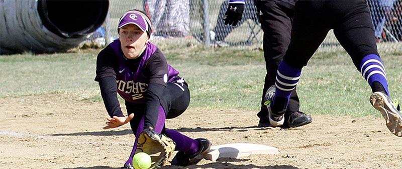 Softball player receives ground ball