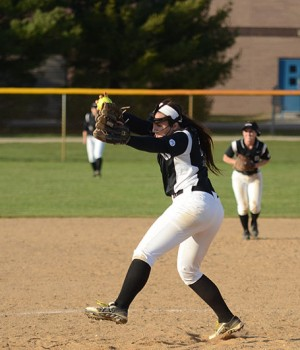 Rae Ann Miller, a first-year, pitches for Goshen College. Photo by Maria Bischoff