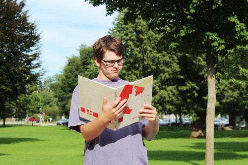 Seth Wesman consults a manual