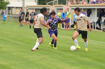 Jose Dominguez Olvera dribbles through a pair of Purdue Northwest defenders.