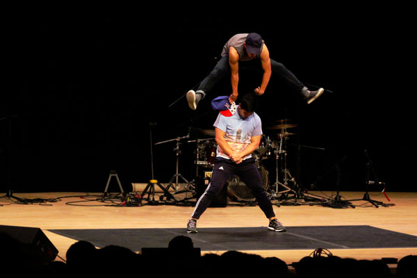 Phil Chan leaps over Nimoy Vaidya during a Kick-Off dance performance in Sauder Concert Hall