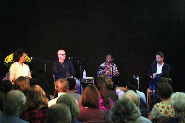 Ellah Wakatama Allfrey, Aminatta Forna, John Freeman, and Aleksander Hemon sit with microphones at the front of classroom Newcomer 19. Many students sit in the audience and listen