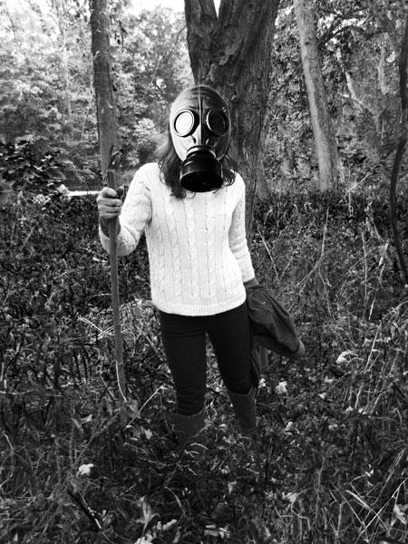 Irina Gladun wears a gas mask in the woods