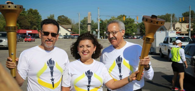 Faculty members run in bicentennial torch relay