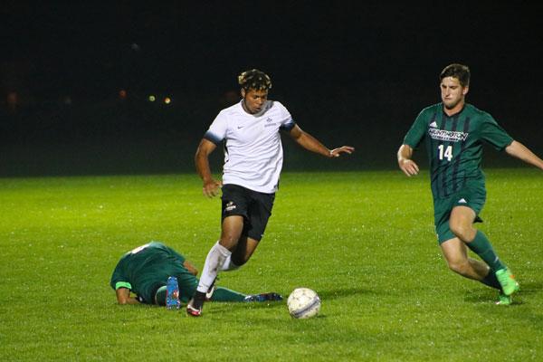 Soccer player dribbles through defenders