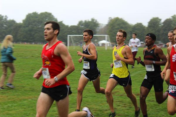Men's cross country runners run across course