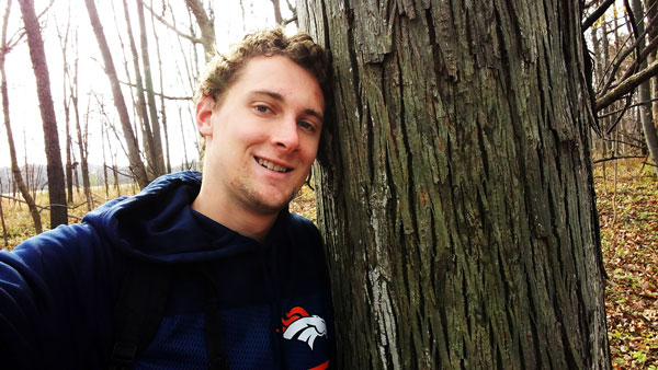 David Leaman-Miller takes a selfie with a hickory tree