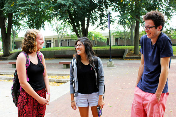 Jesse Bontreger laughs with two other students in Schrock Plaza