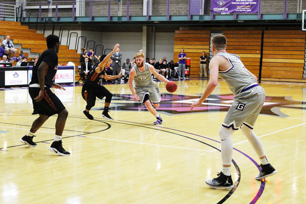 Basketball player drives toward hoop