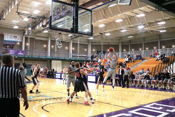 Basketball player takes a mid range jump shot