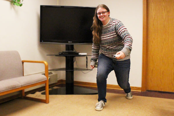 Photo of Jordan Waidelich mid-run next to a TV