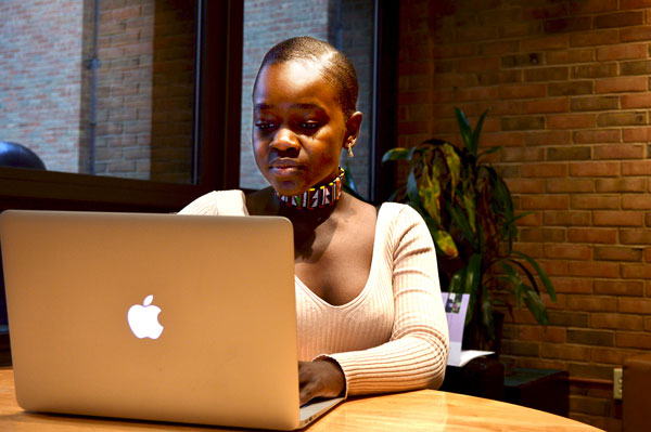Achieng on her laptop