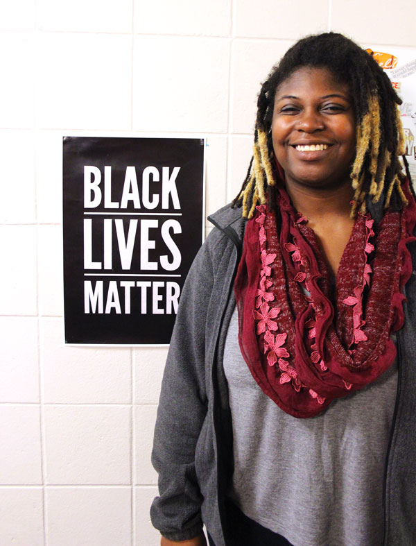 Rachael Klink with BLM poster