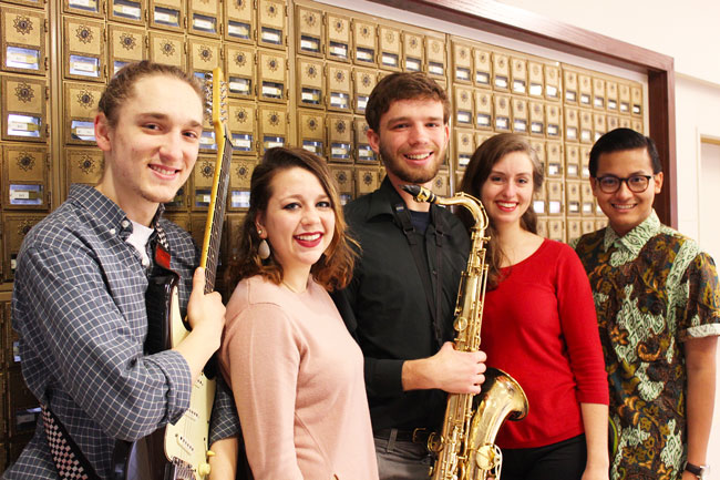 Maggie Weaver, Sadie Gustafson-Zook, Jacob Penner, Galed Krisjayanta and Andrew Pauls pose for a picture with their instruments