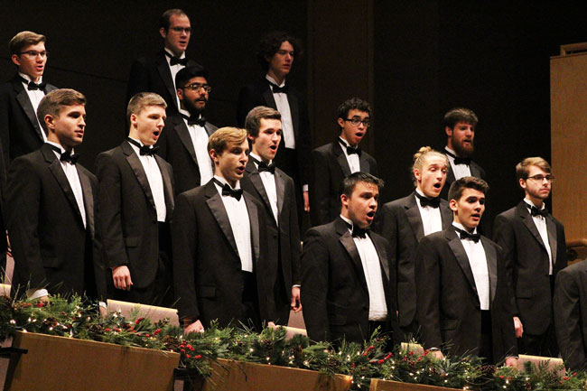 The Goshen men's choir sings in the choral balcony in Sauder Hall
