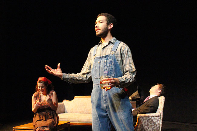 A student performs in a one act on the Umble Center stage
